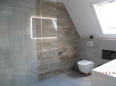 Het gebruik van rustige kleuren in een kleinere badkamer geeft het