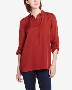 This Long Sleeve Blouse is made of light viscose. It's styled with roll-tab sleeves, a high-low hem and a buttoned neckline. Pair this top with leggings or skinny pants for an easy, chic look.