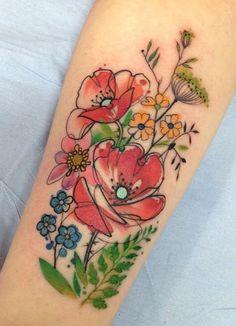 Aga Yadou watercolor flower tattoo