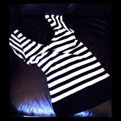 Long Striped Top Stretchy, body conscious, deep V neck front and back is cute. Worn only once or twice. Tops