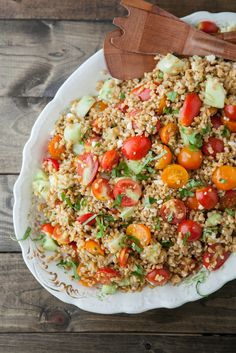 summer farro salad with tomatoes, feta and basil via naturally ella.