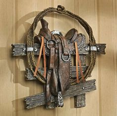 """Texas Cowboys Saddle Western Wall Sculpture by EttansPalace. $38.34. From the horn to the saddle strings, this work of decorative wall art has lassoed authentic all-American Western styling into a piece that any cowboy would love. Cast in quality designer resin to capture the textural details from rough hewn fence to coiled rope, this vintage-style work is hand-painted with Old West pride to highlight faux silver Conchos and tacks.  11½""""Wx3""""Dx11½""""H. 1 lb. Save 20% Off!"""