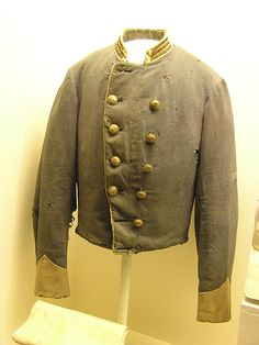 Confederate Officer's Shell Jacket of Capt. James Power Smith, an aid-de-camp of Stonewall Jackson. (He was riding along side when General Jackson was wounded) Double breasted gray wool.Three rows of gold bullion bars on each side of the collar for rank of Captain.  No sleeve braiding present.