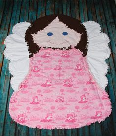 This beautiful angel is made from pre-shrunk, 100% cotton flannel and 100% cotton batting was used inside to make this rag quilt extra snuggly! Measures approx. 38 (wing to wing) x 47. Quilt has been washed once to start ragging process. Machine wash cold; do not use chlorine bleach.    Made for you by me in my smoke-free home. Made from my own original pattern; please do not copy without my permission. International shoppers are welcome -- please contact me for a shipping quote. Thanks for…