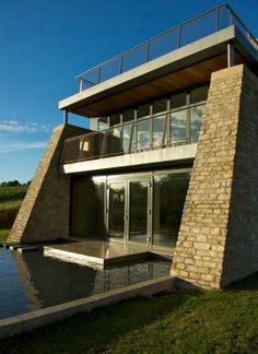 Cotswold stone used in battered walls to this Eco House near Cheltenham, UK