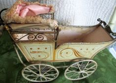Marklin Carriage with pink hood.