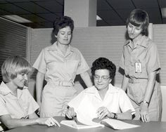 In 1974, an all-female crew of scientists at NASA:  Mary Johnston, Ann F. Whitaker, Carolyn S. Griner, and Doris Chandler.  They were testing experiments for use on the space shuttle and space station.  NASA on the Commons.