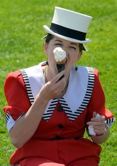 Keeping cool: A lady wearing a jaunty nautical inspired ensemble and a fabulous top hat tucks into an icecream