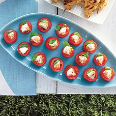 Mozzarella-Stuffed Cherry Tomatoes #recipe. If your tomatoes don't stand upright, cut a small sliver from the bottom to help them lay flat.
