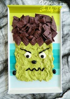 Frankenstein Chips & Dip using blue chips for the hair and guacamole for the face.  We used sour cream to make the eyes and black olives for other details.