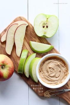 Whip up this easy, 4 ingredient Peanut Butter Dip whenever you need a light, protein-packed snack! Use it to dip apple slices, pretzels, and more. SO peanut-buttery and delicious! Get the recipe at LoveGrowsWild.com