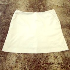 White Talbots Skort Sleek Talbots white skort, with pockets and side slits! Very minimalist design. Easy to dress up or down. Petites size 8, but VERY forgiving! Still looks good on me now even though I wear a size 2, it just sits down at my hips instead of natural waist. I have this same skirt also in Black and Khakis colors. For try-on pix, see the black skort listing. Talbots Dresses