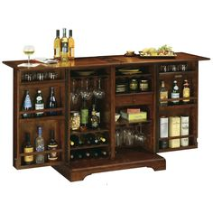 Benmore Valley wine & bar cabinet by Howard Miller. Fully finished wine cabinet, the Benmore Valley wine bar is designed with raised decorative door panels. Wine Bar Cabinet, Wine Cabinets, Bar Cabinets For Home, Storage Cabinets, Mini Bars, Portable Home Bar, Fotos Baby Shower, Bar Console, Bar A Vin