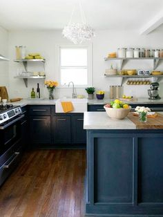 hmmm...now this might be a good compromise. dark lower cabinets, but not too sophisticated. still element of fun and cheery. farmhouse sink modern kitchen, love the dark teal on the bottom cabnets, yellow accents, white upper walls.