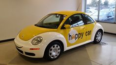 CARite Happy Car - Fenders wrapped in White Vinyl, Smiley face on the front fender, Logo on the sides & website on the rear quarter panel and rear windows