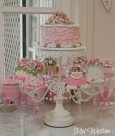 Pastel pink shabby chic faux cakes and ornate cake stand