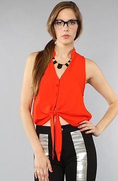 #karmaloop  $54 Women's regular fit sleeveless woven top features a stylish front tie and three pearl chip buttons at the front placket. A clean finish on all hems. 100% Rayon.  By Alternative Apparel