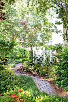 Garden paths can often be found meandering around the sides of homes leading to back yard retreats. #HabershamSC #Beaufort #RealEstate #SouthernLiving #SouthernLivingInspiredCommunity #NewUrbanism #Walkability