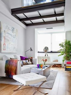 The mini loft is the niche of a modernist who seeks morning coffees over a book, and a home that reflects his or her stylish lifestyle with bright, signature decor....