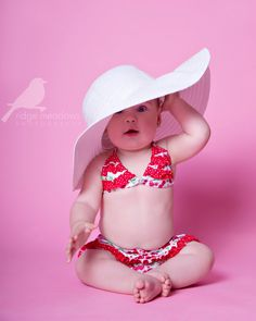 baby in big hat and bathing suit. I die from the cute.THIS IS A MUST TAKE PICTURE WITH THE GIRLS!