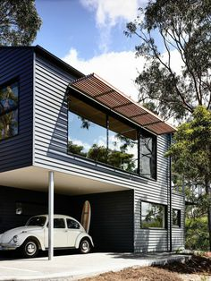 Timber battens were used on north-facing windows to prevent excessive heat in the summer. The exterior is clad in Scyon's Linea weatherboard and covered in Dylux's Western Myall paint. Beneath the upper floor, a little nook makes for the perfect covered c Houses Architecture, Residential Architecture, Architecture Design, Sustainable Architecture, Contemporary Architecture, Contemporary Houses, Australian Architecture, Beach Cottage Style, Beach House Decor