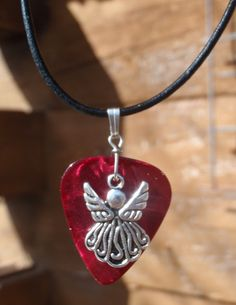 For sale on tophatter pinterest handmade leather angel necklace guitar pick available in blue green pink mozeypictures Choice Image