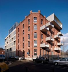 Completed in 2008 in Roubaix, France. Images by Jean-Pierre Duplan photograph. The project deals about the rehabilitation of an old flour-mill and an industrial building in lofts along the canal of Roubaix. Architecture Cool, Container Architecture, Parasitic Architecture, Urban Intervention, Roubaix, Roof Extension, Building Renovation, Adaptive Reuse, Brick And Mortar