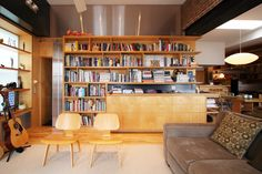 My desire for minimalism stops at the frontier of my love for books.   Pineapple Loft - modern - living room - new york - Resolution: 4 Architecture
