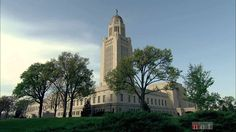 """The Nebraska State Capitol Building and the day """"The Sower"""" was placed atop it......"""