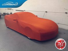 Inferno Orange Satin Stretch Indoor Car Cover for your Corvette C6.  This is the ultimate indoor protection made by Coverking at Anaheim, California.