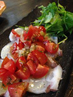 Octopus Carpaccio with marinated tomato