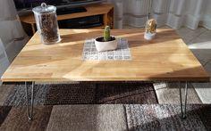 Table basse en bois pied epingle avec carreaux de ciment.
