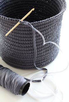 Crocheted basket using plastic hose for strength