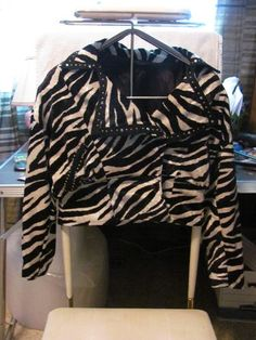 This hot little number By Mesmerize     will satisfy your every style craving    This Jacket is a must have    Hits all the Style Notes    MESMERIZE    WOMENS VINTAGE FAUX ZEBRA JACKET    SIZE LARGE    BUST APPROX 44 IN    32 IN WAIST    20 IN SLEEVE    21 IN LENGTH    2 FAUX POCKETS    BLING AROUND THE    POCKET & COLLAR    FULLY LINED    LONG SLEEVES HAVE SNAP    PADDED SHOULDER    SUPER CUTE JACKET    WONDERFUL ADDITION    TO YOUR WARDROBE