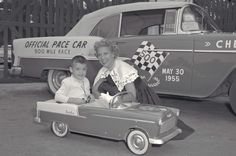 """Dinah Shore, spokeswoman for Chevrolet for years and years posing with a little guy in a pedal car replica of the real 1955 Bel Air Indy Pace Car. """"See the USA in Your Chevrolet"""""""