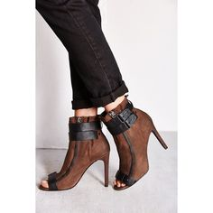 Edgy ankle boots from Dolce Vita in soft nubuck leather. Finished with contrasting straps at the ankle and peep-toe. Complete with exposed zippers at the sides…