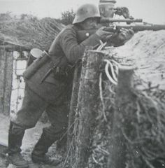 German sniper and his spotter. WW 1.