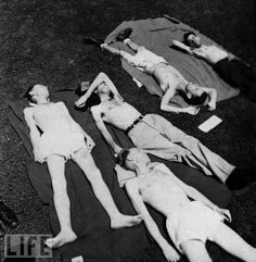 Starvation Experiments at University of Minnesota          Five of the 36 participants in the University of Minnesota's starvation experiments lie and rest on blankets on the university's campus, Minneapolis, Minnesota, 1945. The participants were all conscientious objectors during WWII and volunteered for the experiments as an alternative to military service.