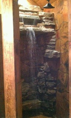 Waterfall shower with many places to put soaps, shampoos, etc In our sauna maybe? Rustic Bathrooms, Dream Bathrooms, Beautiful Bathrooms, Chic Bathrooms, Cabin Homes, Log Homes, Stone Shower, Glass Shower, Waterfall Shower