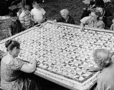 I have never been part of a quilting bee and that makes me so sad. Maybe one day.    [I love how interested the little boys are.]