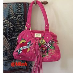 """SALE Ed Hardy pink handbag 'RARE' never worn 2004  Ed Hardy handbag. Vibrant pink with Hardy's  art work some of the best. Pictures speak volumes about this bag. Measures 15"""" x 10"""" drop handle 10"""" and has strap for cross or  shoulder bag. Never Worn didn't want it messed up in any way. It is quite collectible! Ed Hardy Bags"""
