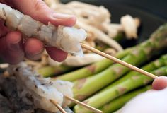 To keep shrimp tempura from curling, slice across the belly (horizontally/inside) & skewer with a medium bamboo skewer
