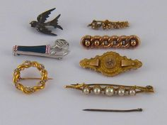 A mixed lot comprising seven untested brooches,one A/F.