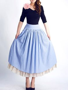 This darling retro inspired serenity maxi skirt is crafted in a blue hued linen fabric , fininsed with a wild wasit band and twin pockets , features an