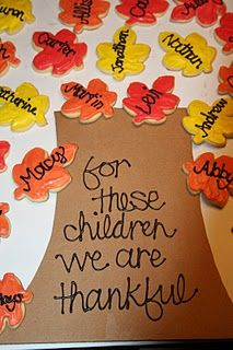 "This is a classroom idea from some place, but with our huge family holiday dinners, we could easily make this with everybody's name on them for the table! :)  ""For this family, we are thankful"""