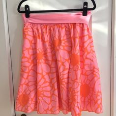 J. Crew Floral Patterned Summer Skirt The most comfortable and adorable skirt you will ever own! Falls just around the knee with orange and pink floral pattern. Super soft cotton with a light weigh layer that is patterned over the top. Stretchy waist band. Size Medium. J. Crew Skirts A-Line or Full
