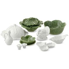 "Cabbage Leaf Dinnerware Collection. Salad Bowls, 6-3/4"" w x 3¼"" h. 16.9oz, $119.95/set of 4. Salad Plates, 7½"", $99.95/set of 4. Salad Serving Bowl, 11½"" w x 5"" h, 11½oz, $69.95. Cheese Plate w/Lid, 13=3/4"" w x 6¼"" h, $99.95/pr. Gravy Boat, 9-3/4"" x 8¼"" x 3¼"", 13½oz, $29.95. Tureen, 13"" w x 7"" h, 67.6oz, $159.95/3-pc set.