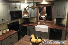 Love the coziness of this rustic kitchen! Cabinets are our Deerfield Shaker II Maple Creek Stone paired with wood countertops.