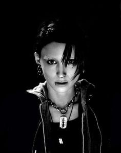 Rooney Mara as Stieg Larsson's Lisbeth Salander. she makes me want a lip piercing so bad.