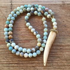 Amazonite stone beaded horn bone necklace NEW 10mm Amazonite stone beaded necklace with a gorgeous bone horn pendant. This necklace is long at 31 inches with an additional 5 inch bone horn drop. Absolutely a head turner.  Goes with everything and can be worn dressed up or down. Tulip3 Jewelry Necklaces